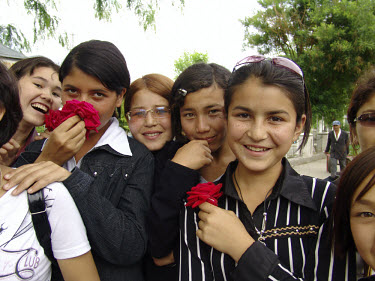 Young girls with flowers.