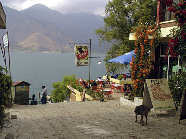 Lake Atitlan and street with a pizza restaurant.