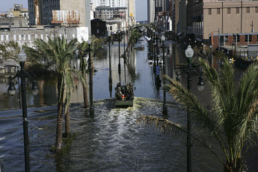 A military patrol along the flooded Canal Street in the aftermath of Hurricane Katrina.
