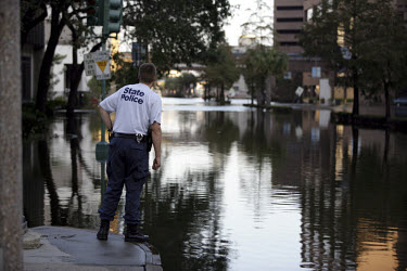 Law enforcement officers looking for ways to get through the flood waters to search for survivors and looters. New Orleans was flooded in the aftermath of Hurricane Katrina.