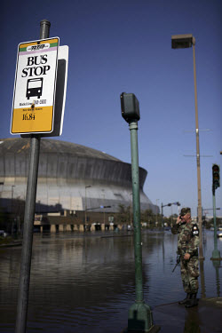 A military policeman outside the New Orleans Superdome, where over 20,000 people took refuge in squalid conditions following the flooding in the aftermath of Hurricane Katrina.