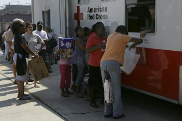 Residents of Covington queue for supplies at a Red Cross aid station. The town was flooded in the aftermath of Hurricane Katrina.