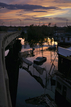 A flooded New Orleans street at sunset in the aftermath of Hurricane Katrina.