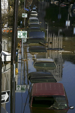Cars submerged in water in the flooded streets of New Orleans after Hurricane Katrina.