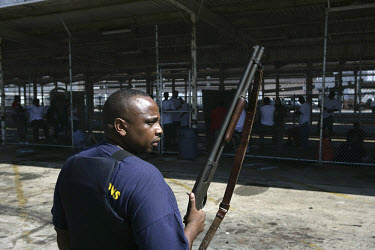 Suspected looters and other detainees are processed and placed in holding cages at the bus station in New Orleans, which was turned into a temporary prison following the anarchy in the wake of Hurrica...