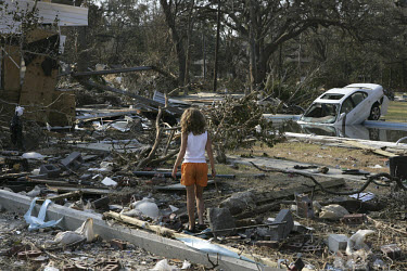 Nine year old Kayla Watson returns with her parents to find her home entirely destroyed by Hurricane Katrina and its tidal surge. The family car is now in their swimming pool.
