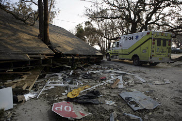 A fire paramedic truck next to a home which collapsed on to a tree when Hurricane Katrina struck the Gulf Coast.