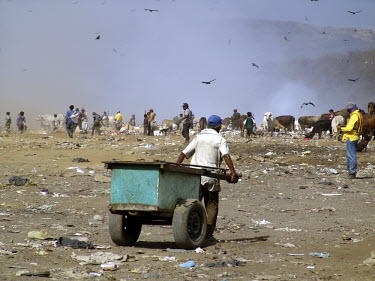 People work scavenging on a rubbish dump on the outskirts of the capital.