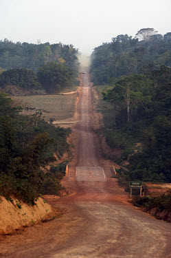 The BR163 highway which serves as a major transport thoroughfare extending through the Amazon rainforest and providing access to the cleared land for loggers, ranchers and farmers.