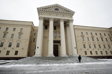 Clearing snow from the steps of a government building on Skorina Avenue.