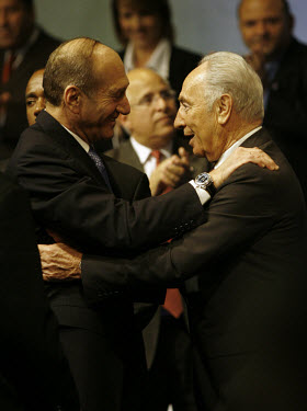 Acting Prime Minister Ehud Olmert and former PM Shimon Peres celebrating their Kadima party's victory in the election.