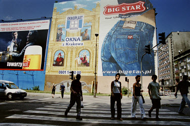 Pedestrians on a zebra crossing walk past a billboard advertising Big Star jeans.