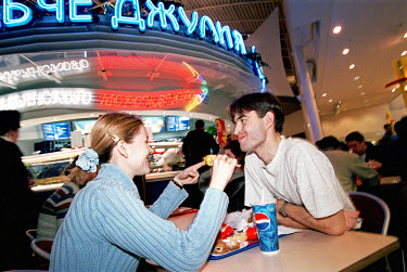 A couple eat at a fast food restaurant in the Mega Centre, one of the largest shopping malls in Eastern Europe.