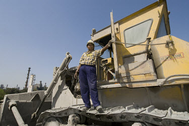 Female bulldozer driver at the Tata Steel Works, India's largest private steel company.