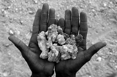 A man holds a crop of frankincense, hardened sap from the Boswellia tree, which is a native plant in the Surud mountains. The tree's sap is tapped and hardened to form frankincense, also known as olib...