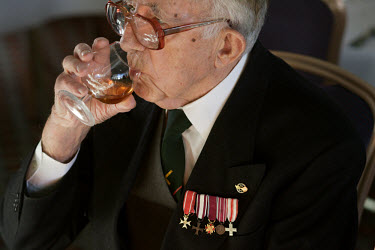 An elderly WWII veteran drinks whisky at the last annual meeting of Polish artillery men who stayed in England after the World War Two.  As the numbers of ex-servicemen at the event get smaller every...
