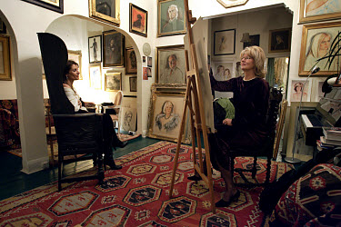 Polish painter Barbara Kaczmarowka-Hamilton works on a portrait of Perla Gray at her studio in Earl's Court.