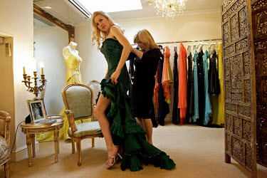 A Ukrainian girl tries on a green dress at the boutique of Polish designers Dana and Liliana Kruszynski.  The exclusive clothing shop is situated in Kensington and is often frequented by celebrities.