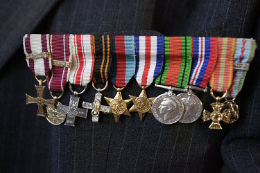 War medals are pinned to the breast pocket of an elderly WWII veteran at the last annual meeting of Polish artillery men who stayed in England after the World War Two.  As the numbers of ex-servicemen...