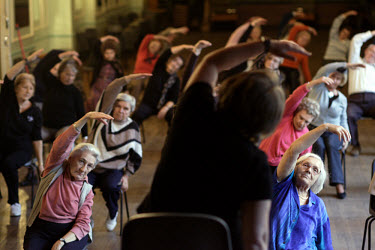 A meeting of senior citizens take part in an exercise session at the 'White Eagle' club in Balham, which acts as a social centre for dancing, eating and recreation.  Most of the elderly Poles who meet...