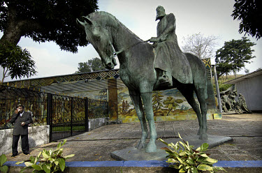 A bronze statue of King Leopold II of Belgium on horseback in the garden of the National Museum depot. The statue was removed from the city centre in 1997 when Laurent Kabila took power, changed the c...