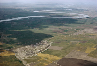 The new Assyrian capital of Nimrud. The Assyrian Empire was ruled from here in the early 9th century, when the River Tigris, now meandering several kilometres away, protected the southern side of the...