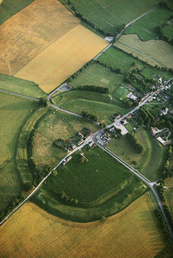 The Avebury henge and stone circles, surrounded by a ditch, which is one of the largest prehistoric enclosures in Europe. The monolithic was first erected in around 2600 BC and is a UNESCO World Herit...