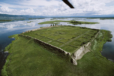 Uighur Island fortress in Lake Tere-Khol in a region ruled by the Uighurs in the 8th and 9th centuries. The solid mud walls and corner towers of the fortress remain visible, along with the outlines of...