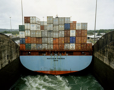 A Maersk container ship passes through the Gatun lock of the Panama Canal.
