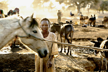 Sudanese refugees living close to the border, having fled the violence in Darfur. Around 4,000 refugees were gathered at the wadi (river) with their livestock. Knowing that they would have to leave th...