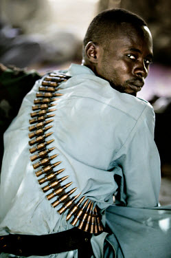 A Janjaweed militiaman attending a meeting with border police and Chadian military close to the border with Sudan. The Janjaweed have been terrorising the native population of Darfur since 2003, and l...