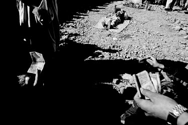 Salesman Sherali Armani selling medicine on the streets three months after the 2005 Kashmir earthquake. The 7.6 magnitude quake that hit the area on 8th October 2005 killed over 80,000 people. Balakot...