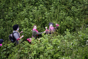 Protestors, dressed as clowns, from the Clandestine Insurgent Rebel Clown Army (CIRCA) escape from police towards the A9 after attending demonstrations during the G8 summit.