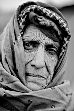 Budleajan lost her twenty-year-old son, Gulam, during the 2005 Kashmir earthquake. 'My husband works in Saudi Arabia and the government will not allow him to travel back to me. He has not been here af...
