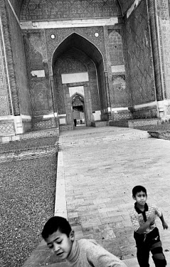 Children playing in the ancient city of Bukhara. Bukhara has been declared a Unesco World Heritage Site.