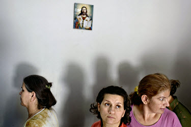 Iraqi refugees waiting for food distribution at the Christian Church of Abraham in the Jaramana neighbourhood. The church provides some of the poorer refugee families with a free daily meal. Over one...