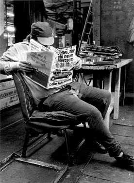 A worker reading the newspaper during a break at the VEB Sachsenring Automobilwerke factory. VEB Sachsenring, an East German car manufacturer, ceased production of its iconic Trabant at the end of 199...