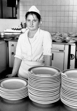 A catering worker at the VEB Sachsenring Automobilwerke factory. VEB Sachsenring, an East German car manufacturer, ceased production of its iconic Trabant at the end of 1991.