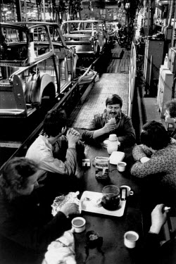 Workers on a break at the VEB Sachsenring Automobilwerke factory. VEB Sachsenring, an East German car manufacturer, ceased production of its iconic Trabant at the end of 1991.