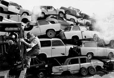 The breaking and destruction of Trabant cars at a scrap yard outside the former VEB Sachsenring Automobilwerke factory. VEB Sachsenring, an East German car manufacturer, ceased production of its iconi...