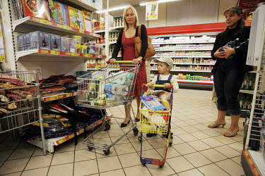Mother and child in a supermarket.