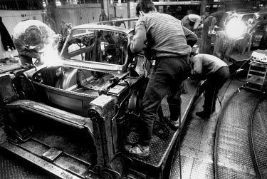 Labourers working on the production of the last few Trabant cars at the VEB Sachsenring Automobilwerke factory. VEB Sachsenring, an East German car manufacturer, ceased production of its iconic Traban...