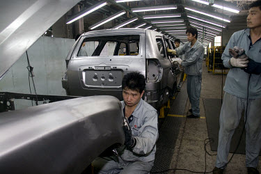 Workers on the assembly line at the Hebei Zhongxing Automobile Company (ZXAuto) car factory in Baoding.