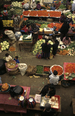 Maya villagers selling vegetables at the Sunday market.