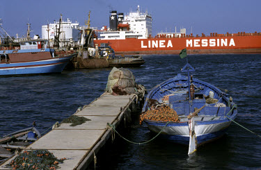 Cargo ships and fishing boats in the harbour.