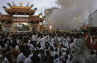 Worshippers attend the Lantern Pole Raising ritual at the Jui Tui Shrine during the Chinese Festival of the Nine Emperor Gods (locally known as the Phuket Vegetarian Festival). The ceremony is held to...
