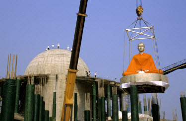 The enshrining of a large Buddha image (4.5 m high) at Wat Phra Dhammakaya temple. Officially founded in 1977, the Phra Dhammakaya temple has since faced much controversy due to its adaptation of trad...