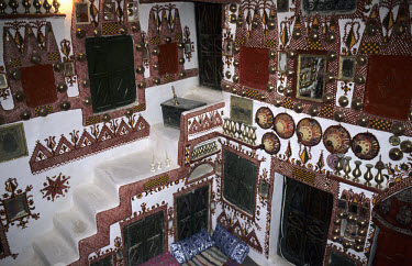The decorated interior of a house in the medina (old city) in Ghadames. The Berber community that once lived here was resettled in 1982. However, many former residents still use the houses in the medi...