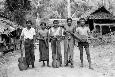 Kayan (Karenni) men, refugees from Burma, with their traditional musical instruments.