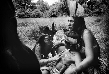 A family group of indigenous people from the Amazon region.